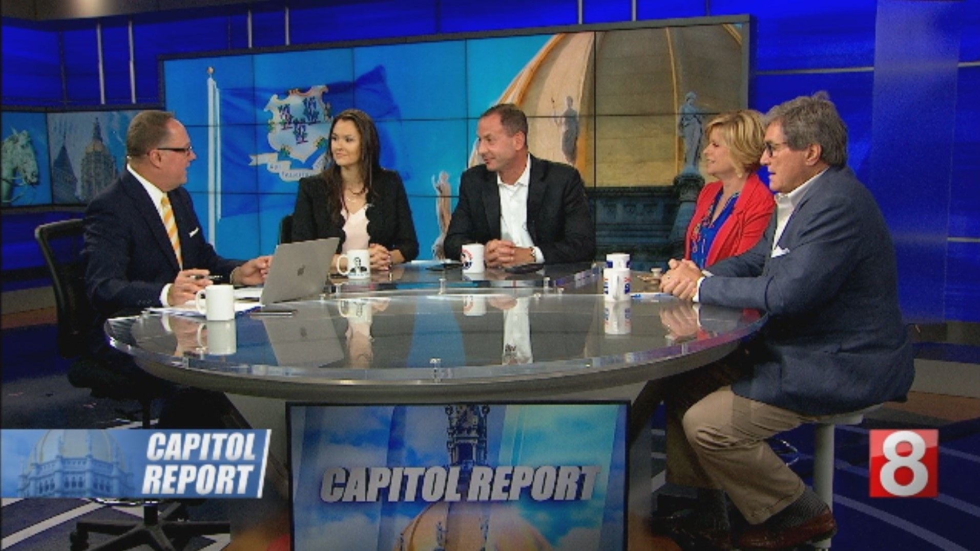 TV News show with 5 people around the table discussing Capitol Report